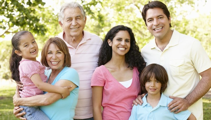 Multi-generational family poses for a picture.