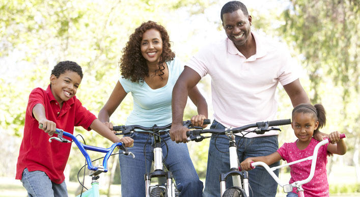 Family takes a bike ride together.